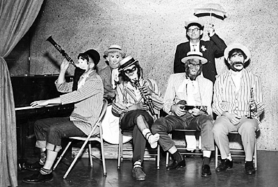 "The opening day of ""Slam Bang Theater"" on KTVT Channel 11. Icky Twerp with the umbrella and members of his House Ape Band."